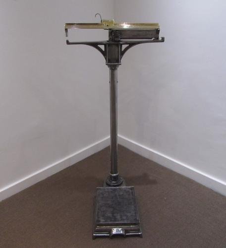 A pair of gymnasium weighing scales