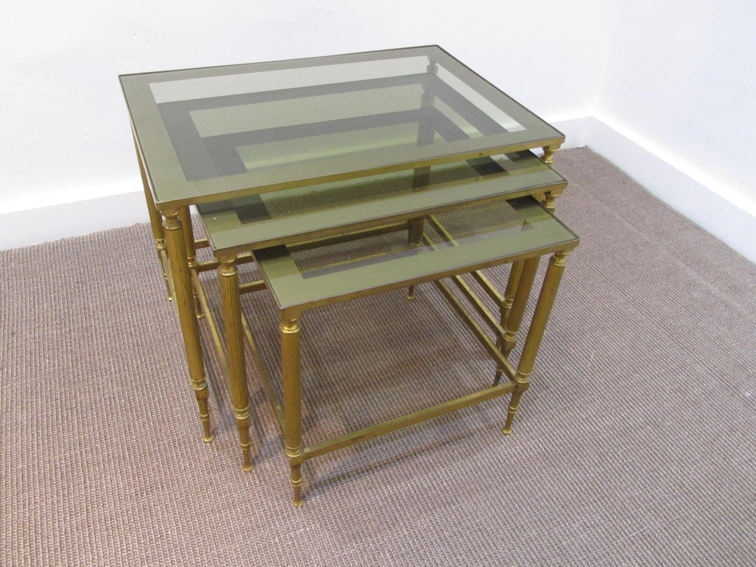 A set of brass nesting tables