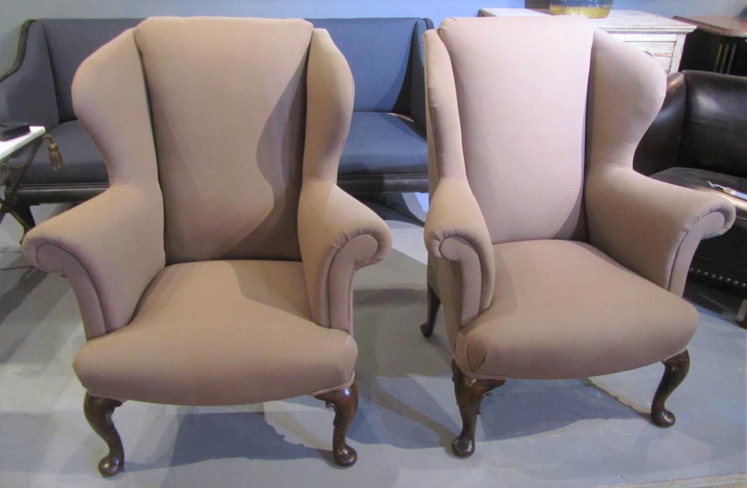 A pair of walnut wing chairs