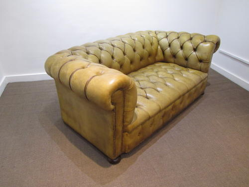 A Petite leather chesterfield sofa