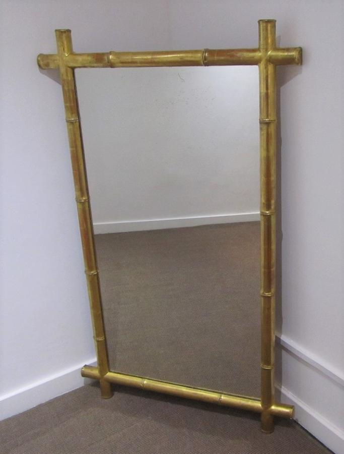 A gilt wood faux bamboo mirror
