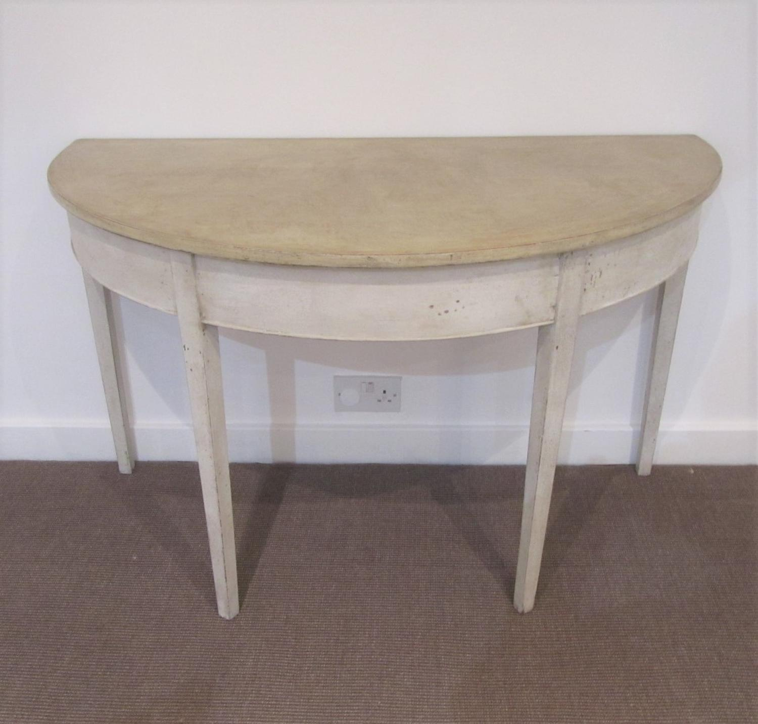 A single painted demi lune table