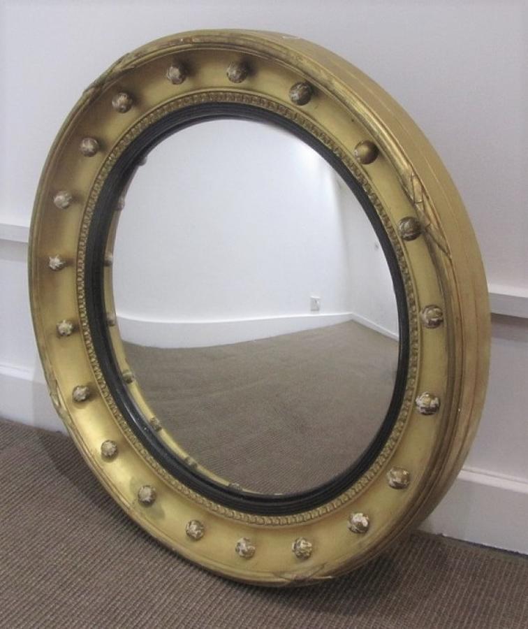 A gilt convex mirror