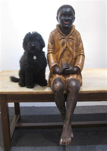 A carved wood Negro boy Advertising figure