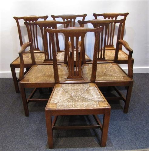 A set of six English provincial oak dining chairs