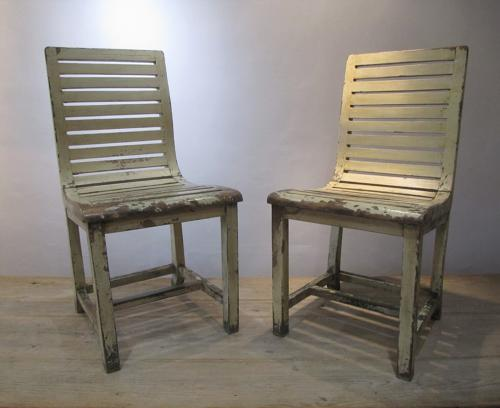 A pair of French slatted side chairs