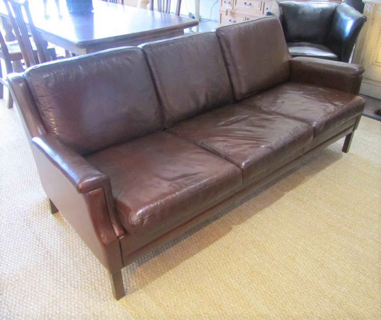 A three seater Danish leather sofa