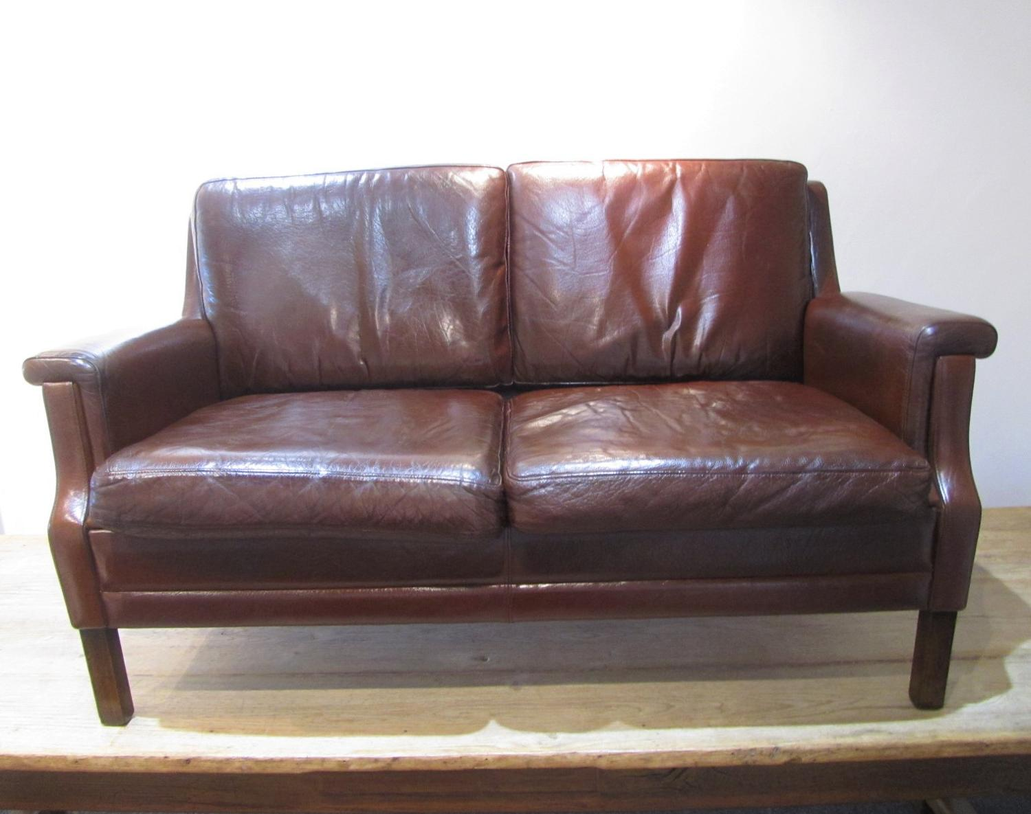 A Danish two seater leather sofa
