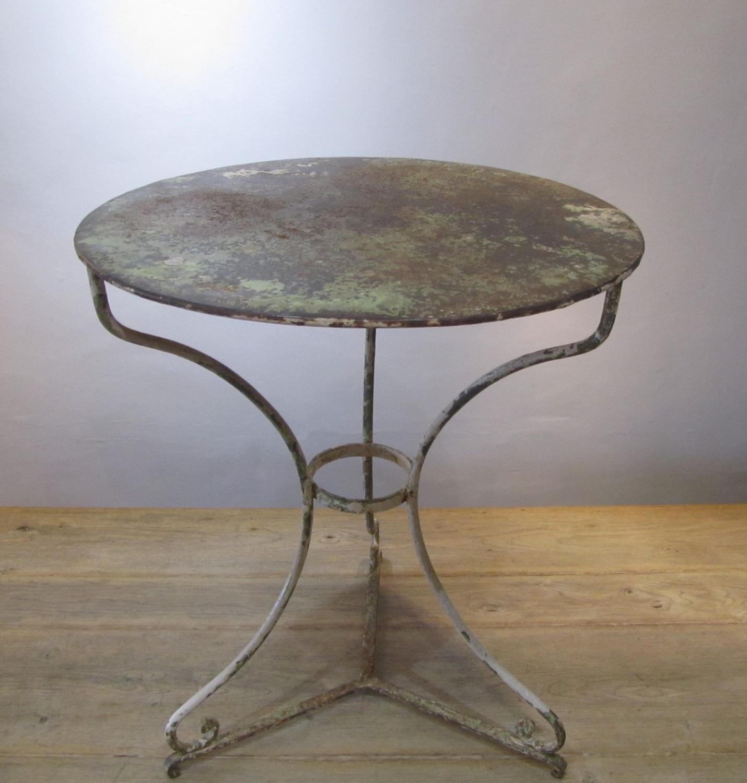 A wrought iron Gueridon table