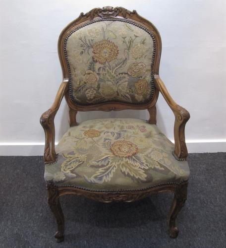 A Walnut and needle point fauteuil