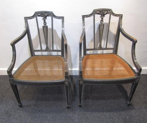 A pair of caned Sheraton style side chairs