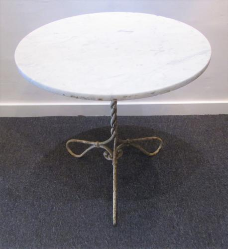 A wrought iron Gueridon table
