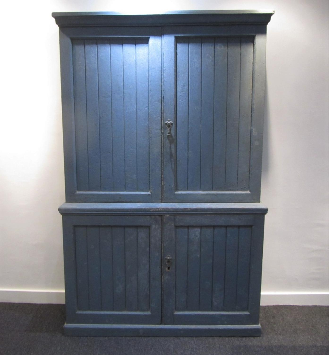 A painted two piece school cabinet