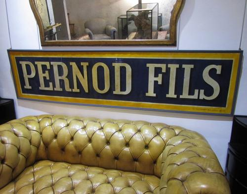 A large Pernod Fils advertisement