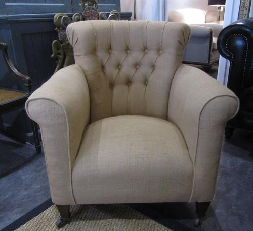 A Victorian buttoned armchair