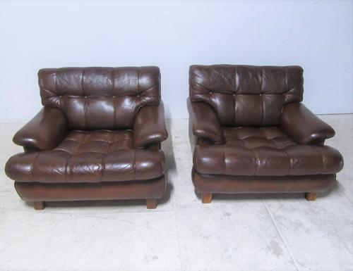 A pair of leather chairs by Arne Norrell