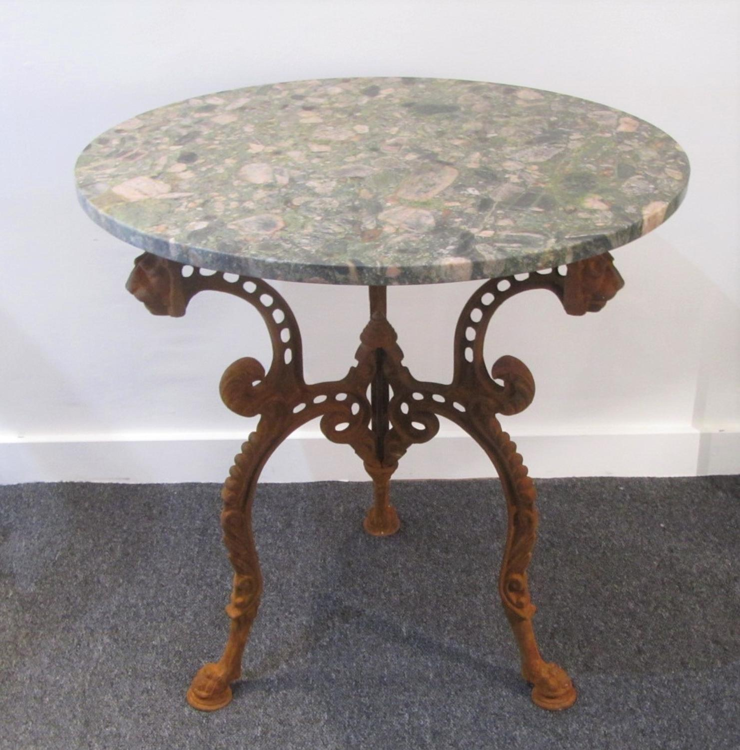 A cast and marble side table