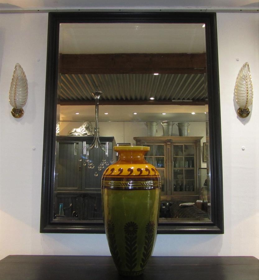 A large black bistro mirror