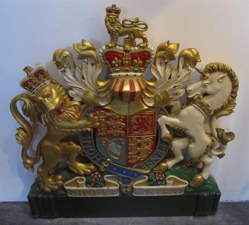 A carved wood royal coat of arms