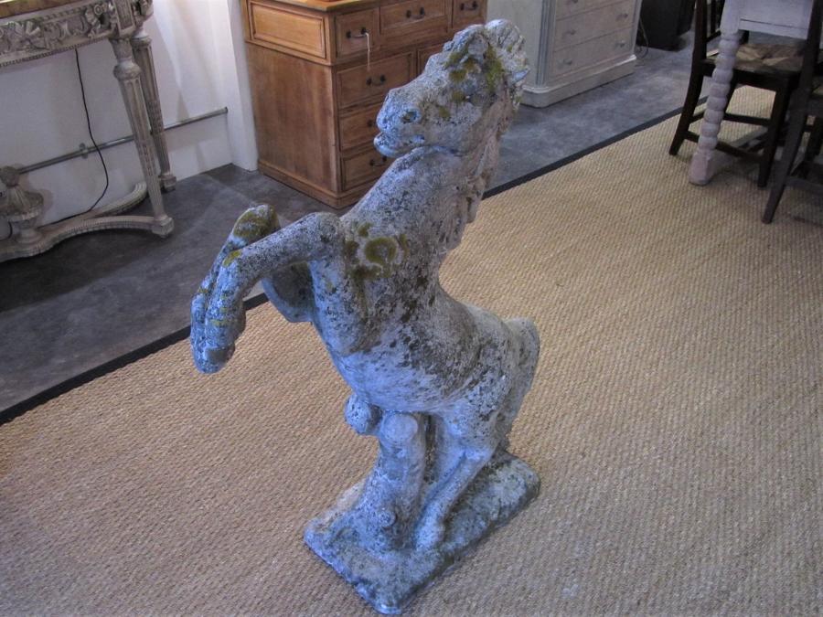 A prancing horse garden statue