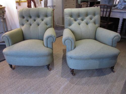 A pair of deep buttoned armchairs