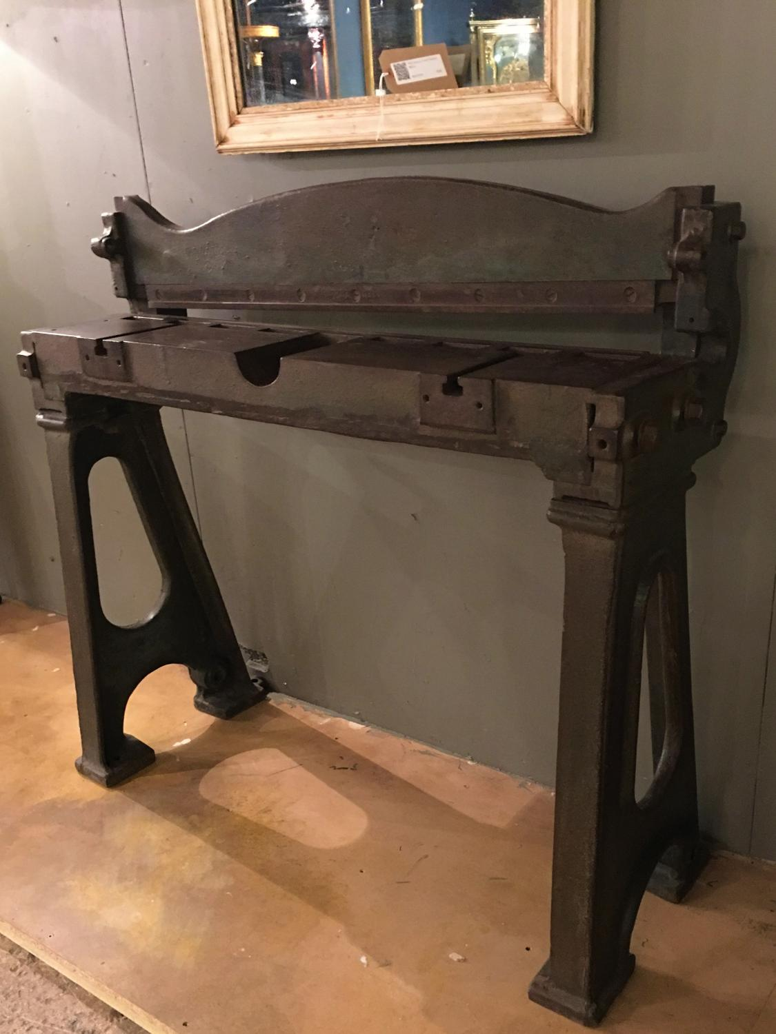 A cast iron Guillotine steel cutter console table