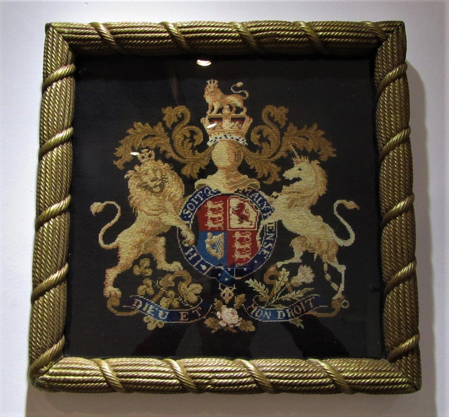 A needle point royal coat of arms