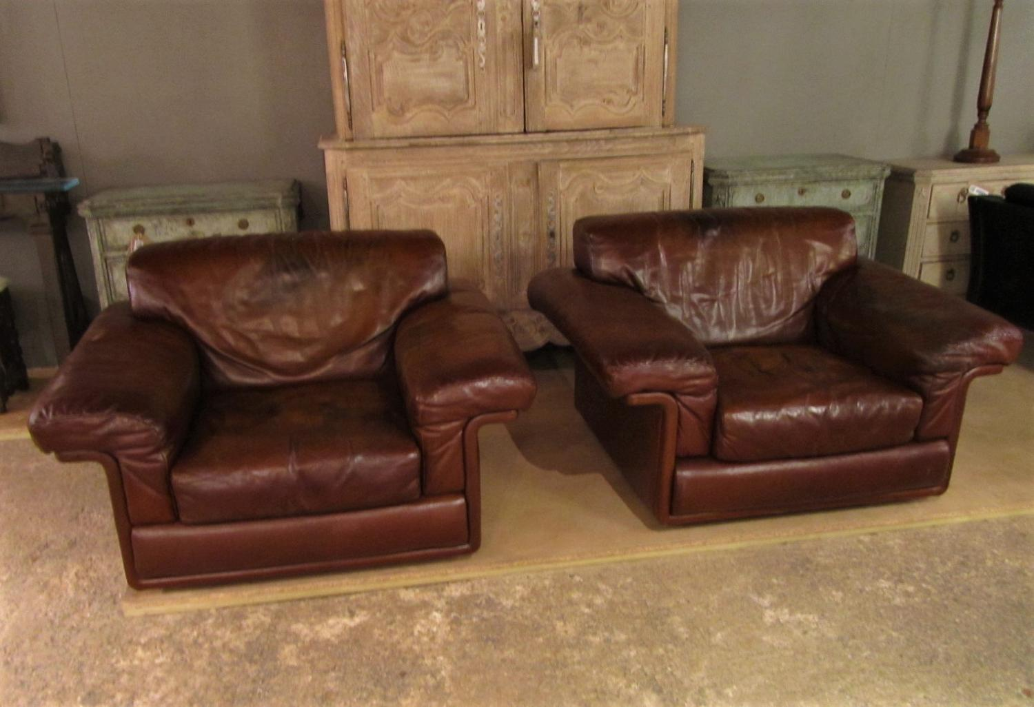 A pair of DeSede leather chairs