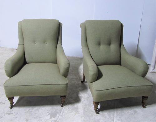 A pair of upholstered armchairs