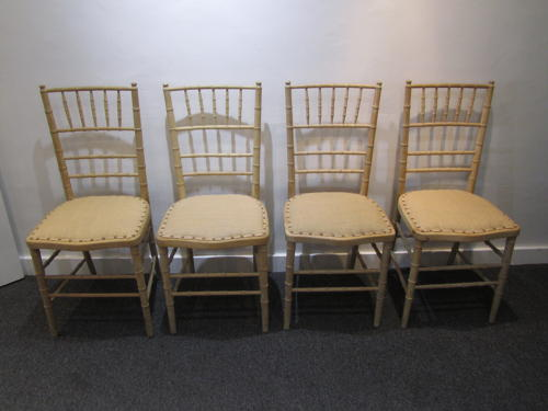A set of 4 regency faux bamboo side chairs