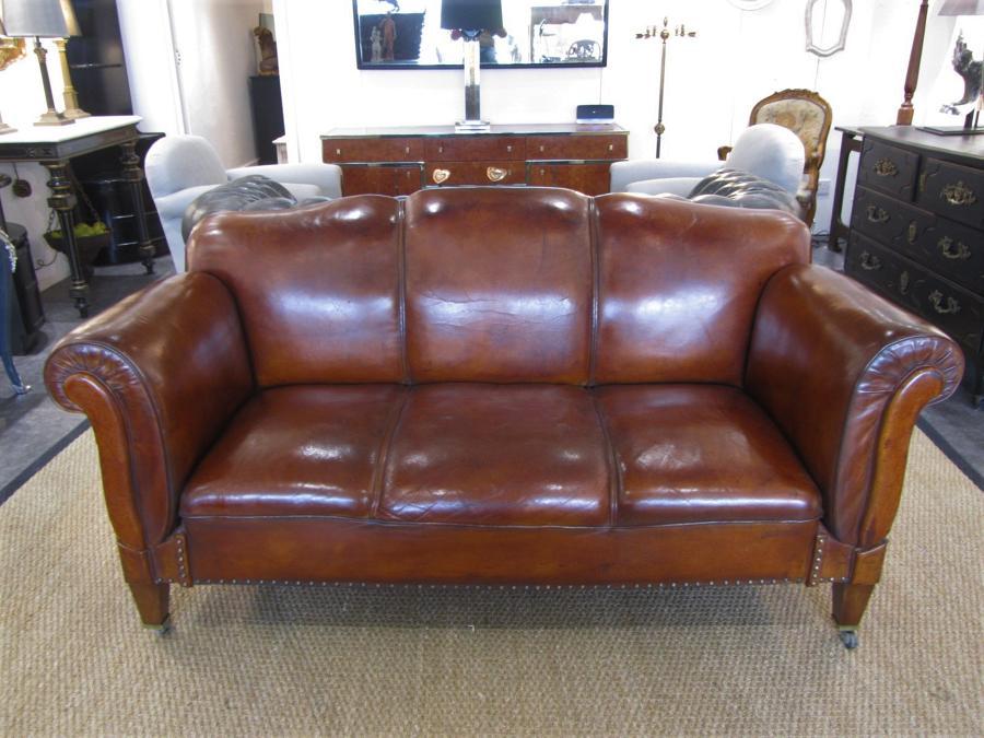 A leather double drop arm club sofa