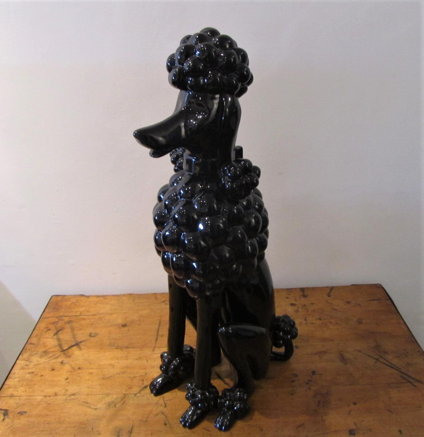A ceramic 70's seated Black Poodle