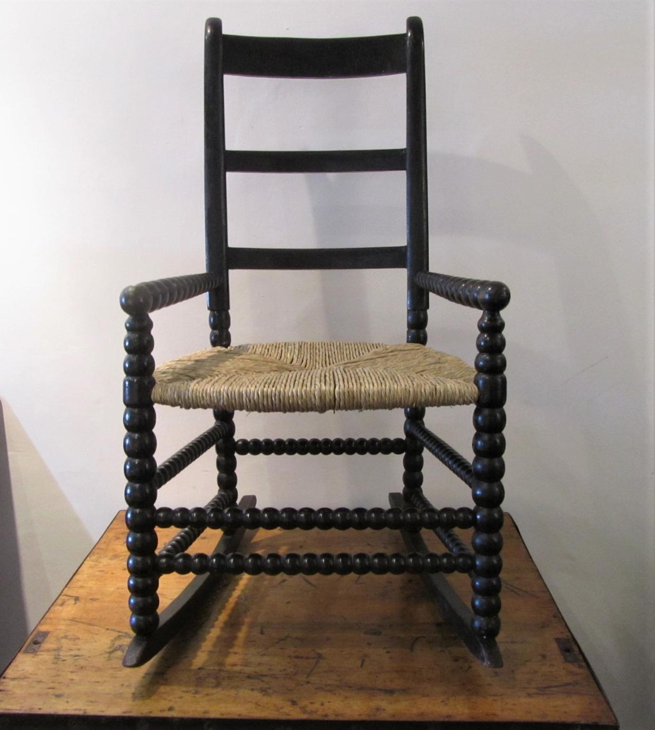 A bobbin turned folk art rocking chair