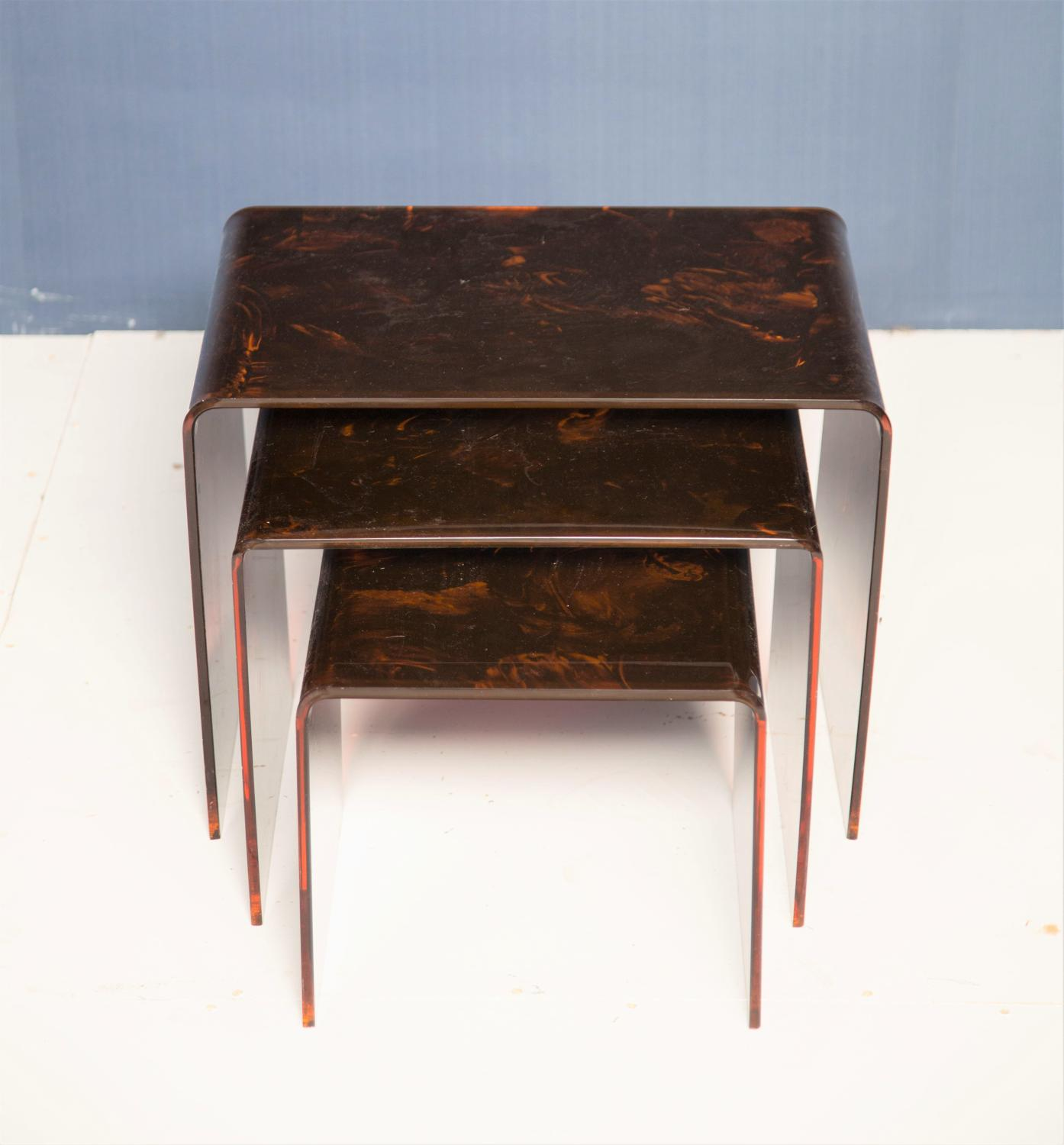 A nest of faux tortoise shell lucite tables