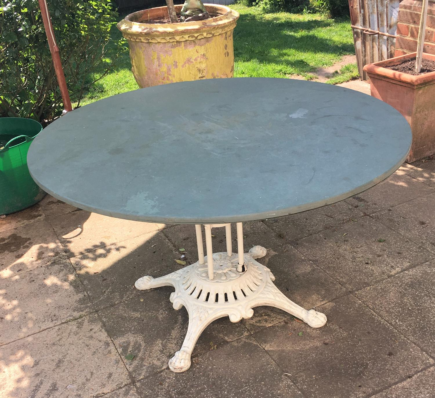 A 19thC cast iron and slate top cafe table