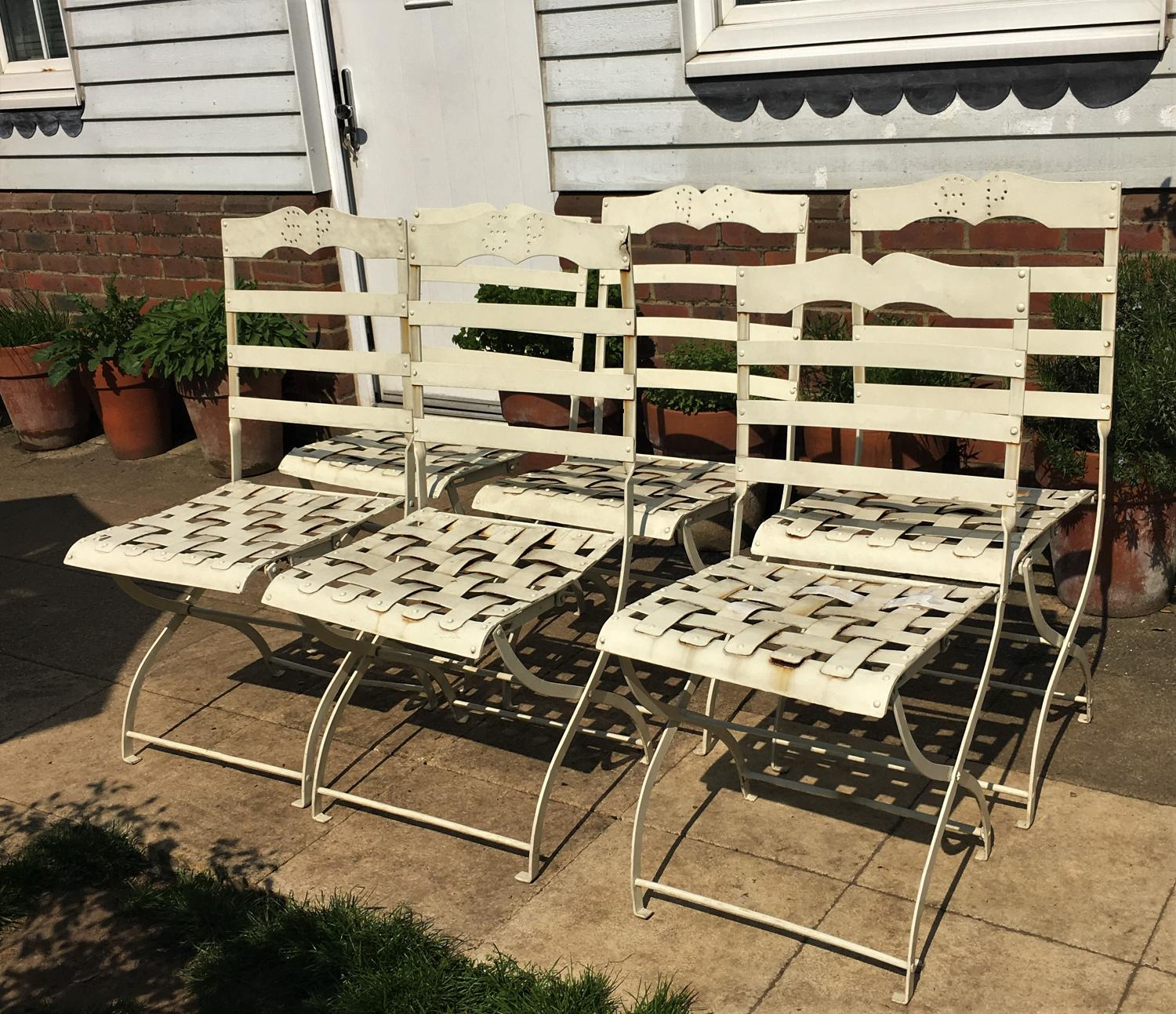 A set of six large wrought iron bandstand chairs