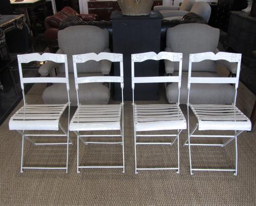 A set of four folding bandstand chairs