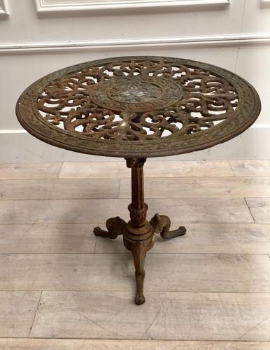 A circular cast iron garden table