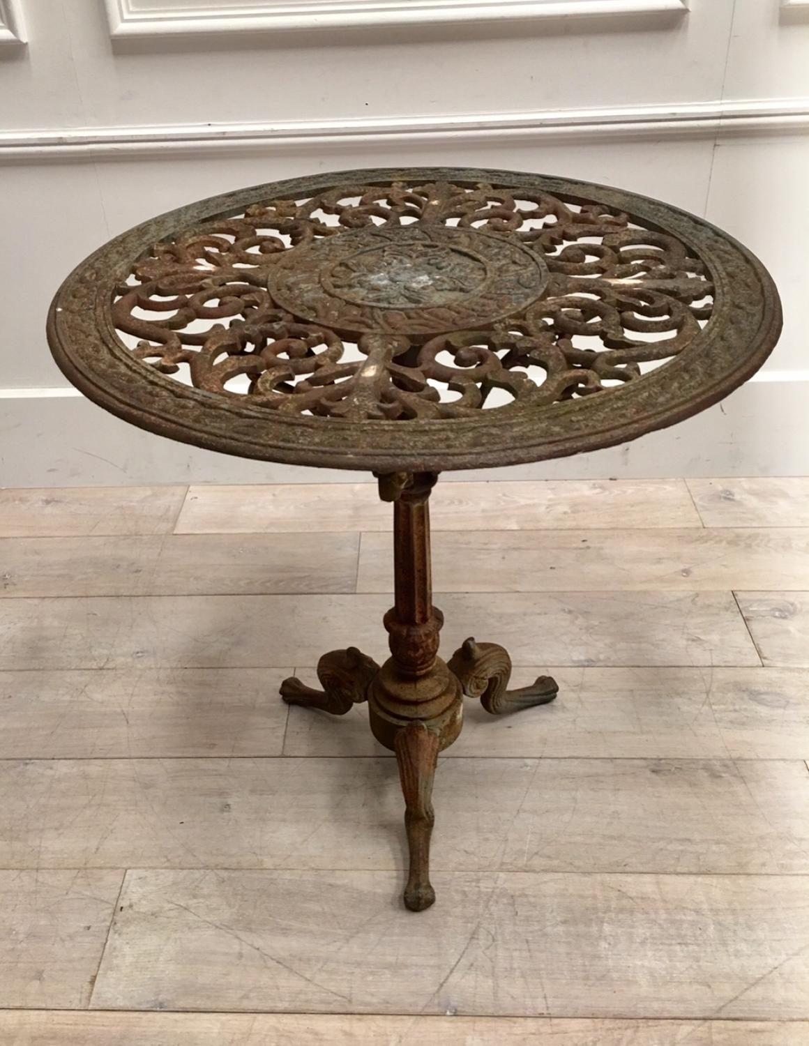 A circular cast iron garden table