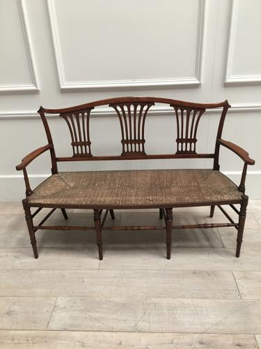 A 19thC Fruitwood settee bench
