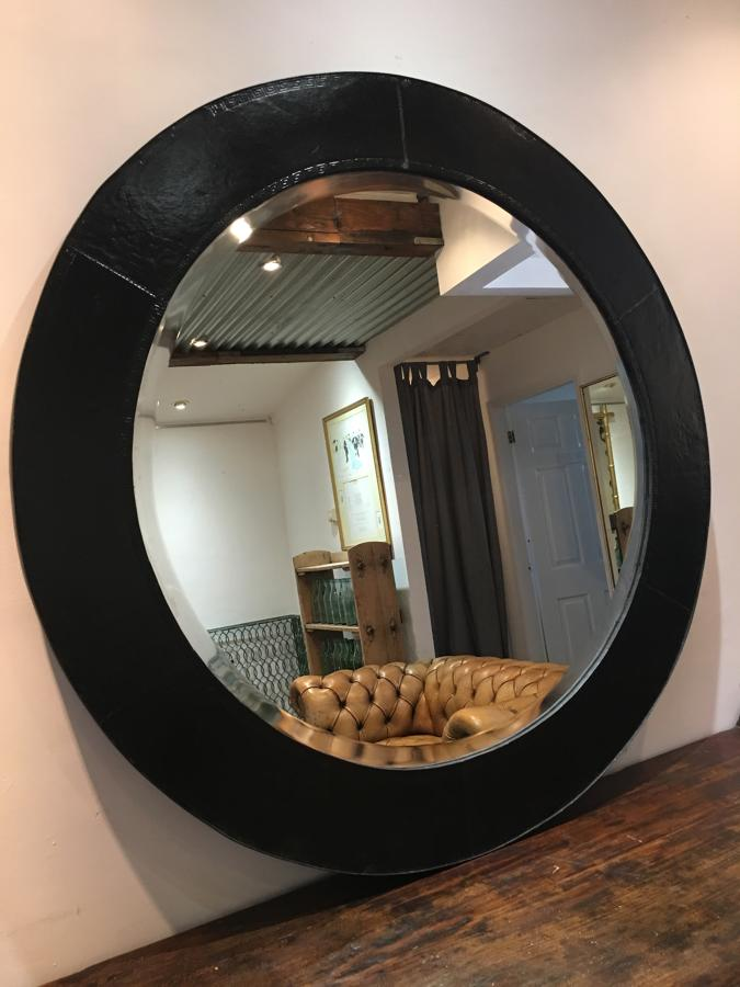 A Mid century circular leather bound mirror