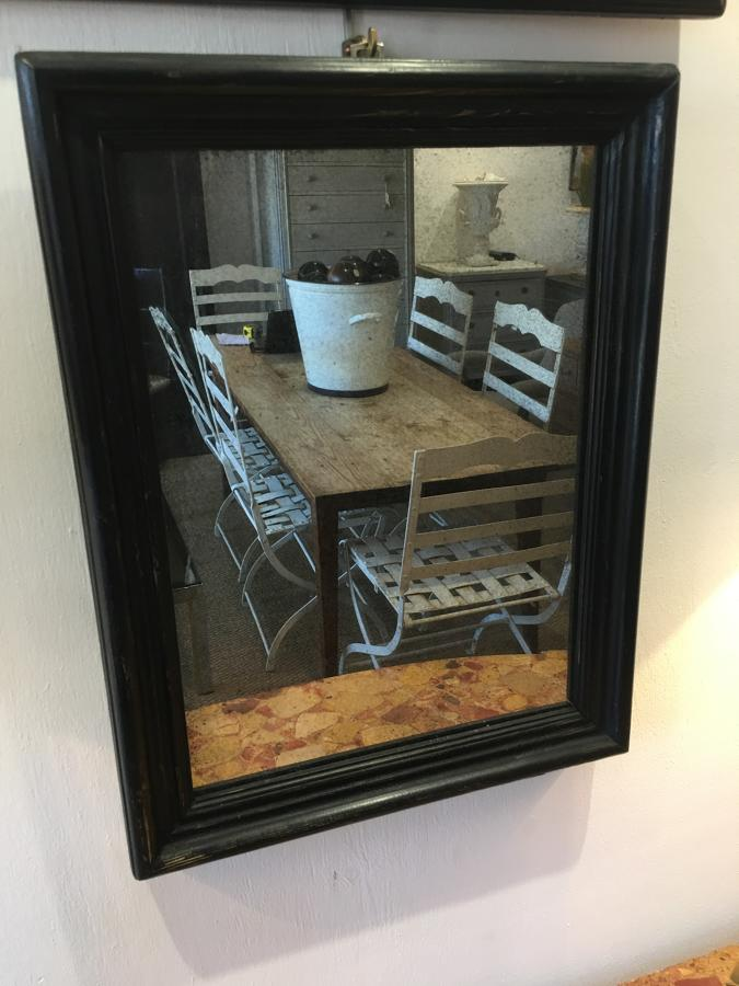A small black foxed plate mirror