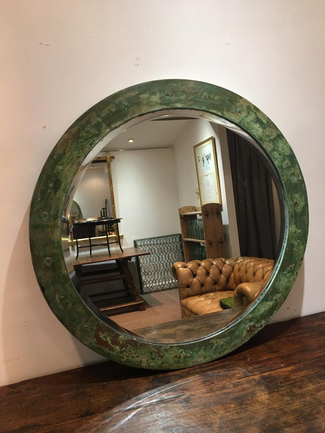 A Mid 20thC copper bound circular mirror