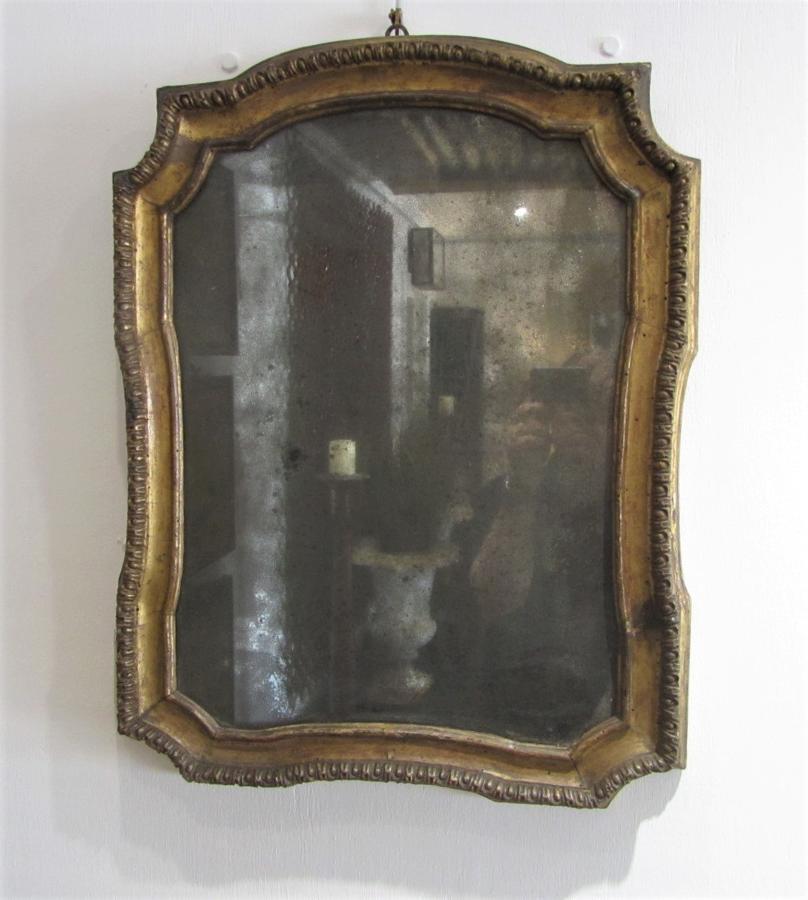 An 18thC giltwood mirror