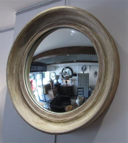 A late 19thC large convex mirror