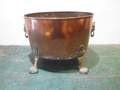 A copper and brass wine cooler / coal bucket