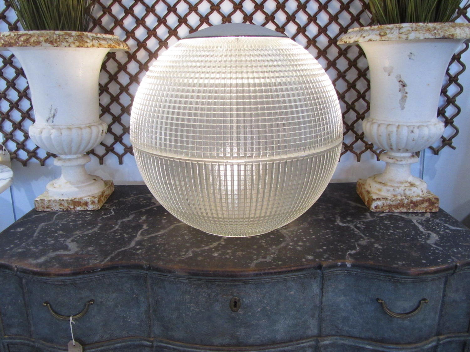 A large glass holophane globe light