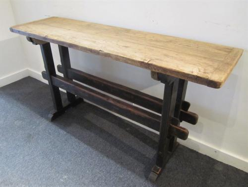 A trestle form console table