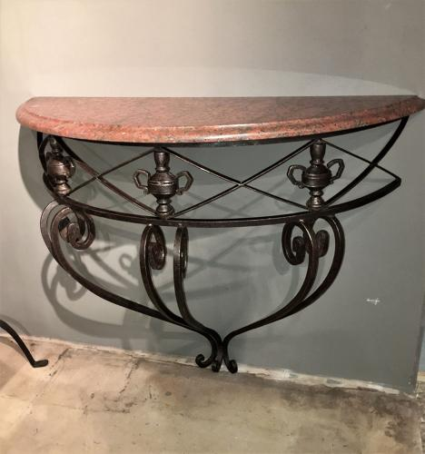 A mid century iron and marble console