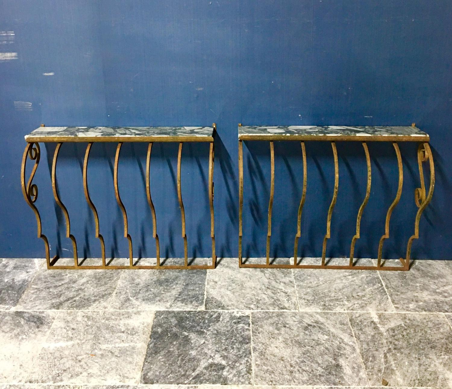 A pair of wall hanging console tables